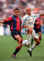 Marc Overmars (Barcelona) and Attilio Lombardo (Lazio). Barcelona v Lazio. The Amsterdam Tournament. Amsterdam Arena, 5/8/2000. Credit: Colorsport / Stuart MacFarlane.