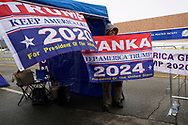 Walter Roach, a supporter of U.S. President Donald Trump, shows off a banner outside a site for Trump's rally taking place the next day, in Des Moines, Iowa, U.S., January 29, 2020. REUTERS/Rick Wilking