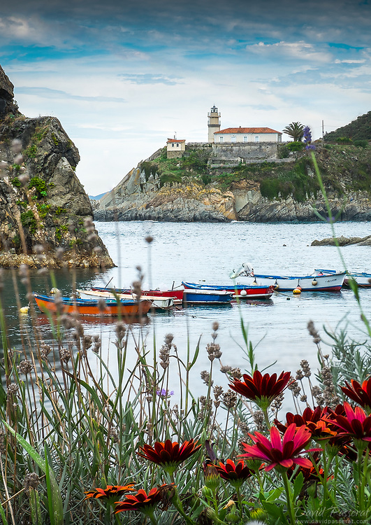 Cudillero port with boats and lighthouse.