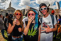People in the crowd smoking pot at the 420 Cannabis Culture Music Festival, Civic Center Park, Downtown Denver, Colorado USA. This was the first 4/20 celebration since recreational pot became legal in Colorado January 1, 2014. A crowd of up to 80,000 people attended the event.