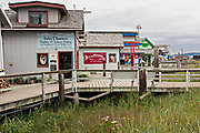 Restaurants and shops along the marsh boardwalk on Homer Spit on Kamishak Bay in Homer, Alaska.