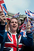 April 29th 2011 Royal Wedding. Trafalgar Square. Crowd waving flags .