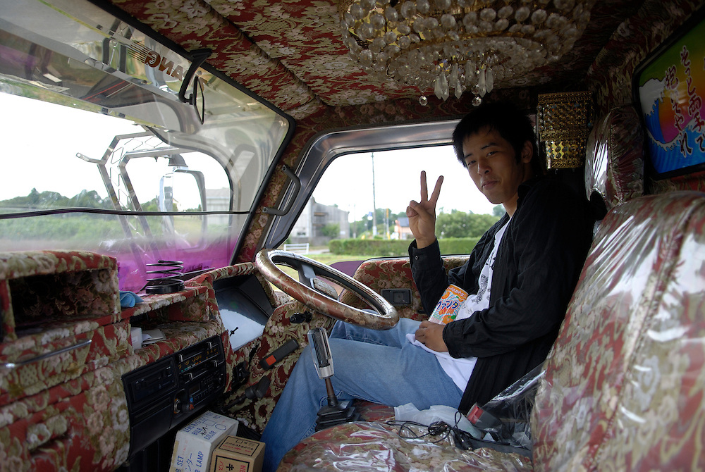 Kiyotaka Takahashi in a customized truck. The bicycles are smaller versions.