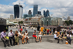 © Licensed to London News Pictures. 15/07/2014. London, UK. People enjoying the sunshine near Tower Bridge in central London this lunchtime. Photo credit : Vickie Flores/LNP