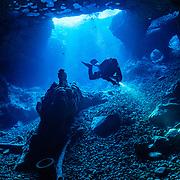 A SCUBA diver descends into a cave in Florida, USA.