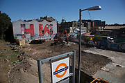 Street art view from Hackney Wick Overground station of the HW initialled Olympic Coca Cola mural in Hackney Wick, East London, United Kingdom. Street art in the East End of London is an ever changing visual enigma, as the artworks constantly change, as councils clean some walls or new works go up in place of others. While some consider this vandalism or graffiti, these artworks are very popular among local people and visitors alike, as a sense of poignancy remains in the work, many of which have subtle messages.