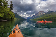 Sea kayaking on Bowman Lake in Glacier National Park, Montana, USA
