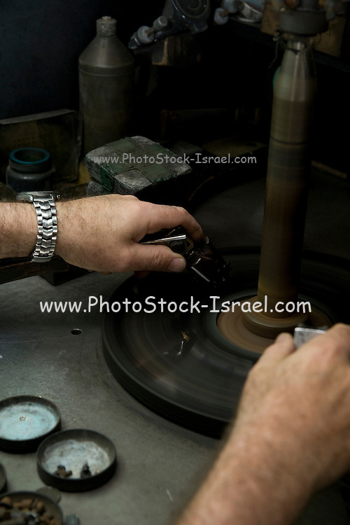Israel, Interior of a diamond cutting and polishing workshop. A workers work station