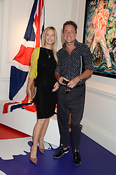 JEREMY HEALY and EMMA WOOLLARD at Ronnie Wood's Raw Instinct Summer Party held at Castle Fine Art, Bruton Street, London on 9th July 2013.