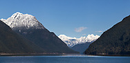 Fresh snow on Mount Gatey above Alouette Lake with Mount Clark, Mount Breier and Stonerabbit Peak (L to R) in the distance.  Photographed from South Beach on Alouette Lake in Golden Ears Provincial Park, Maple Ridge, British Columbia, Canada