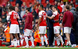 Arsenal's Aaron Ramsey says goodbye to team mates on the pitch after the final whistle of the Premier League match at the Emirates Stadium, London.
