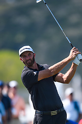 March 21, 2018 - Austin, TX, U.S. - AUSTIN, TX - MARCH 21: Dustin Johnson watches his approach shot during the First Round of the WGC-Dell Technologies Match Play on March 21, 2018 at Austin Country Club in Austin, TX. (Photo by Daniel Dunn/Icon Sportswire) (Credit Image: © Daniel Dunn/Icon SMI via ZUMA Press)
