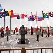Raising the Flags of the original 12 Antarctic Treaty signatory nations. The 12 flags are flown during the Austral Summer when the sun does not set.