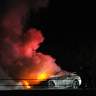 A car fire is put out by firefighters on 422 eastbound near mile marker 176 in Limerick Township, Pennsylvania. (Photo by Matt Smith)