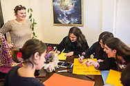 Members of the Kampüs Cadıları (Campus witches) make placards for the upcoming international women's day on March 8th 2018, at a cafe in Kadıköy district of Istanbul, Turkey.