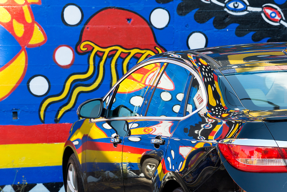 Mural and reflection on car, Olympia, Washington.