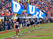 CHARLOTTESVILLE, VA- NOVEMBER 12: Duke Blue Devil cheerleaders runs with flags during the game against the Virginia Cavaliers on November 12, 2011 at Scott Stadium in Charlottesville, Virginia. Virginia defeated Duke 31-21. (Photo by Andrew Shurtleff/Getty Images) *** Local Caption ***