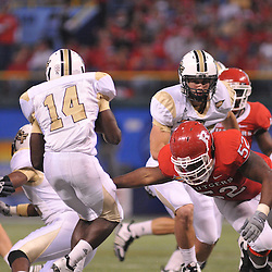 Dec 19, 2009; St. Petersburg, Fla., USA; Rutgers defensive end Eric Legrand (52) reaches out to tackle UCF wide receiver Quincy McDuffie (14) during NCAA Football action in Rutgers' 45-24 victory over Central Florida in the St. Petersburg Bowl at Tropicana Field.