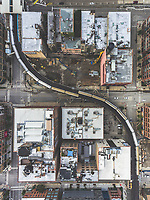 Aerial view of a train crossing over empty streets due to the corona virus pandemic at Chicago, United States.
