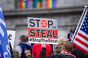 """A demonstrator holds a sign during a """"Stop the Steal"""" rally in Harrisburg, Pennsylvania on January 5, 2021. Supporters of President Donald Trump urged legislators to decertify the election during the rally at the Pennsylvania State Capitol. (Photo by Paul Weaver)"""