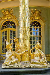 Gilded statues in the Chinese Teahouse at Sanssouci Gardens Potsdam , Berlin, Germany a UNESCO World Heritage site