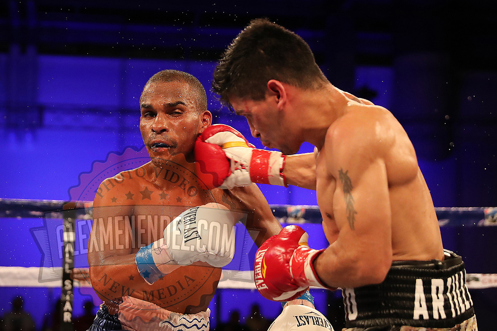 "Jonathan ""Bomba"" Gonzalez gets punched by Julian ""El Nino Artillero"" Yedras during a Telemundo boxing match for the WBO Latino Flyweight Title at Osceola Heritage Park on Friday, July 20, 2018 in Kissimmee, Florida.  (Alex Menendez via AP)"