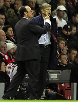 Photo: Paul Thomas.<br />Liverpool v Arsenal. The FA Barclays Premiership. 28/10/2007.<br /><br />Managers Rafael Benitez (L) of Liverpool and Arsene Wenger (R) of Arsenal get close. *** Local Caption *** *** UK ONLY ***