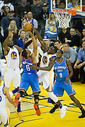 Golden State Warriors forward Draymond Green (23) blocks a lay up by Oklahoma City Thunder guard Russell Westbrook (0) at Oracle Arena in Oakland, Calif., on November 3, 2016. (Stan Olszewski/Special to S.F. Examiner)