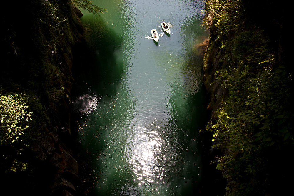 TAKACHIHO, JAPAN - Boat touring in the takachiho river. Small falls in the left. April 2009