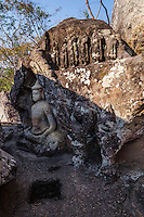 Tham Phra Buddha Cave at Phu Phra Bat -  one of the premier attractions in Isaan although its location in rural Udon Thani province keeps the crowds at bay. Large boulders appear to balance on top of impossibly small rocks, rimmed by ancient Buddha images shrouded in legend. Phu Phra Bat combines a beautiful landscape along a forest trail speckled with religious arts going back over 3000 years. The park's huge mushroom shape rock formations were the result of erosion that took place when the terrain was under the sea millions of years ago. Narrow sandstone stems hold up the weight of harder and larger chunks of rock up above them. Similar formations can be seen at Pha Taem national park but those at Phu Phra Bat are more spectacular, as if defying the laws of gravity.  The most haunting set of stones is found at Kou Nang Usa, known as Thai Stonehenge.  Ranging in height from one to three meters, seven markers have stood through the centuries in a circle surrounding a jagged rock formation rising from a broad stone floor.