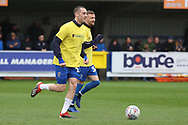 AFC Wimbledon midfielder Dylan Connolly (16) and AFC Wimbledon attacker Shane McLoughlin (38) warming up during the EFL Sky Bet League 1 match between AFC Wimbledon and Accrington Stanley at the Cherry Red Records Stadium, Kingston, England on 6 April 2019.