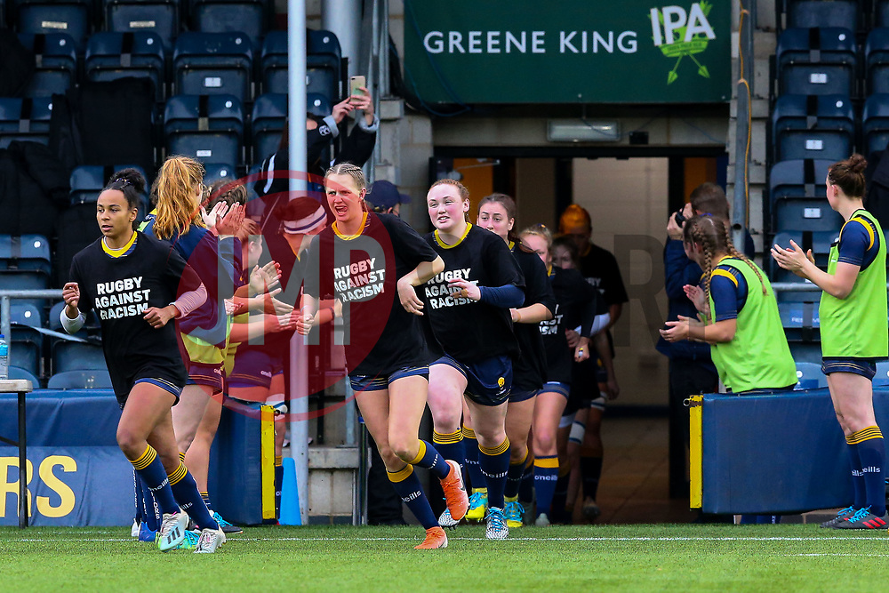 Worcester Warriors Women run onto the pitch, wearing Rugby Against Racism tee shirts - Mandatory by-line: Nick Browning/JMP - 24/10/2020 - RUGBY - Sixways Stadium - Worcester, England - Worcester Warriors Women v Wasps FC Ladies - Allianz Premier 15s