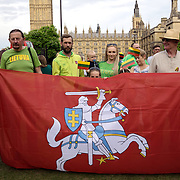 London,England,UK, 6th July 2016 : Lithuanian  community celebration Lithuania's National Day is a day Lithuanian State first crown King in the 13th Century singing national anthem at Parliament square, London. Photo by See Li