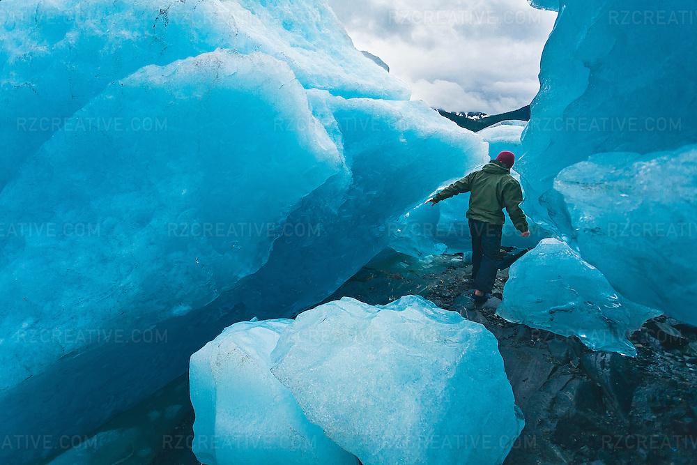 Man exploring Mendenhall Glacier, outside of Juneau, Alaska.