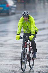© Licensed to London News Pictures 03/01/2021.        Sidcup, UK. A cyclist getting very wet. Heavy rain in Sidcup, South East London this Sunday afternoon as a weather warning has been issued for a -12C Arctic chill in the UK. Photo credit:Grant Falvey/LNP