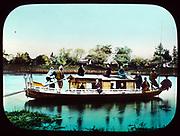 Houseboat on a river in Japan, 1895. Hand-coloured lantern slide.