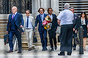 """The US actor Johnny Depp carrying a bouquet of flowers leaves the High Court in London on Friday, July 24, 2020 - after attending a hearing in his libel case against the publishers of The Sun and its executive editor, Dan Wootton. <br /> 57-year-old Depp is suing the tabloid's publisher News Group Newspapers (NGN) over an article which called him a """"wife-beater"""" and referred to """"overwhelming evidence"""" he attacked Ms Heard, 34, during their relationship, which he strenuously denies. (VXP Photo/ Vudi Xhymshiti)"""