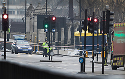 © Licensed to London News Pictures.23/03/2017.London, UK. A tent covers the area (R) where the attacker's car came to a halt on Westminster Bridge near Parliament, the day after a lone terrorist killed 4 people and injured several more, in an attack using a car and a knife. The attacker managed to gain entry to the grounds of the Houses of Parliament, killing one police officer.Photo credit: Peter Macdiarmid/LNP