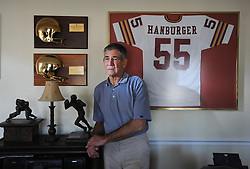 20110202 SP/HANBURGER - Former Redskins NFL linebacker, Chris Hanburger, may be voted into the Pro Football Hall of Fame this weekend. .     Hanburger and his wife, Evelyn, have retired to South Carolina. Their home office is a showcase of trophies, awards and a framed #55 Redskins jersey. Black & white photographs from his football career hang in the upstair's quilting room..     An unassuming Hanburger points to his wife as the one who has put his trophies and football memorabilia on display . © Laura Mueller -www.lauramuellerphotography.com