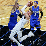 ORLANDO, FL - MARCH 01: Nikola Vucevic #9 of the Orlando Magic blocks a shot attempt by Kristaps Porzingis #6 of the Dallas Mavericks during the second half at Amway Center on March 1, 2021 in Orlando, Florida. NOTE TO USER: User expressly acknowledges and agrees that, by downloading and or using this photograph, User is consenting to the terms and conditions of the Getty Images License Agreement. (Photo by Alex Menendez/Getty Images)*** Local Caption *** Nikola Vucevic; Kristaps Porzingis
