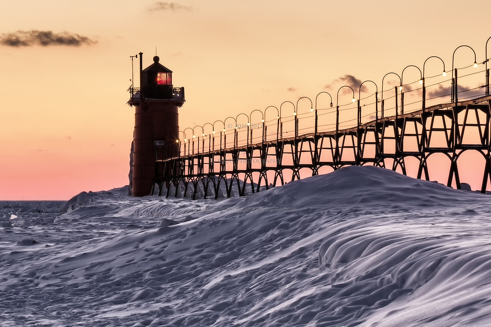 The South Haven pier rests quietly under winter's snowy blanket.