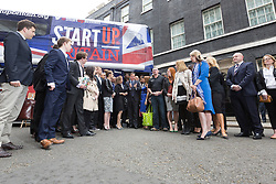 © Licensed to London News Pictures. 23/06/2015. London, UK. DAVID CAMERON speaking to entrepreneurs at the launch of the Start-Up Britain campaign routemaster bus in Downing Street, London with Prime Minister, David Cameron. Over five weeks the routemaster bus will visit 30 towns and cities - including Aberdeen, Inverness, Swansea York and Leeds - and aim to engage with 15,000 individuals through workshops and networking events, making them aware of the assistance Start-Up Britain can offer. Photo credit : Vickie Flores/LNP