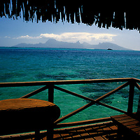 Oceania, South Pacific, French Polynesia, Tahiti. View of Moorea from the overwater bungalow at the Tahiti Intercontinental Resort Hotel & Spa in Papeete.