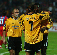 Photo. Daniel Hambury.<br /> UEFA Cup.<br /> Panionios V Newcastle United. 21/10/2004<br /> Newcastle's Shola Ameobi is congratulated after winning the penalty