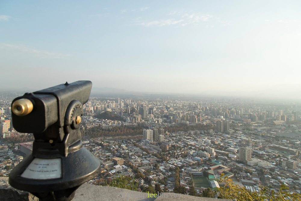 View of city, coin-operated binoculars, sky and horizon from San Cristobal Hill, Santiago, Chile
