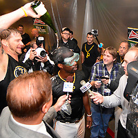 Pittsburgh Pirates A.J. Barnett pour champagne on to Pittsburgh Pirates center fielder Andrew McCutchen (22) in the clubhouse following the 6-2 win against the Cincinnati Reds at PNC Park in Pittsburgh, on October 1, 2013.   UPI/Archie Carpenter