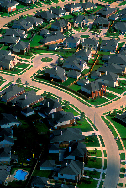Aerial view of winding streets and cul de sacs in a suburban neighborhood in Houston, Texas.
