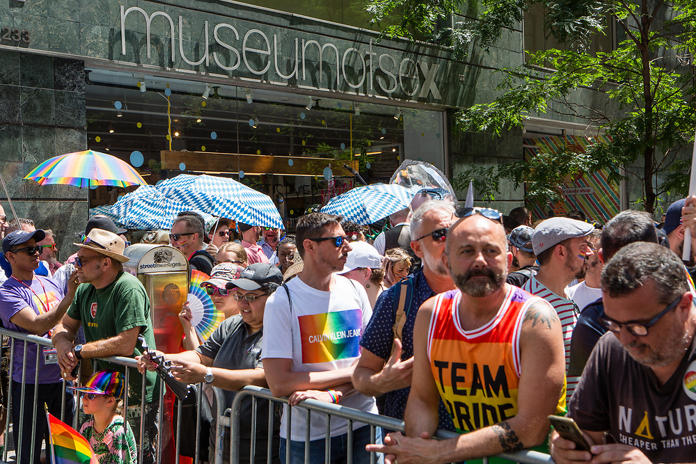 New York, NY - 30 June 2019. The New York City Heritage of Pride March filled Fifth Avenue for hours with participants from the LGBTQ community and it's supporters. Spectators line the sidewalks in front of the Museum of Sex prior to the start of the march.