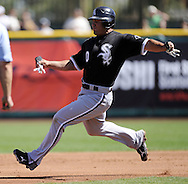 SCOTTSDALE, AZ - MARCH 09:  Carlos Quentin #20 of the Chicago White Sox bats against the San Francisco Giants on March 09, 2011 at Scottsdale Stadium in Scottsdale, Arizona. The Giants defeated the White Sox 4-2. (Photo by Ron Vesely)