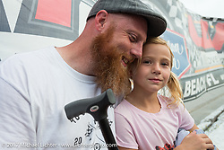 Matt Harris with his daughter at Billy Lane's Sons of Speed vintage motorcycle racing during Biketoberfest. Daytona Beach, FL, USA. Saturday October 21, 2017. Photography ©2017 Michael Lichter.
